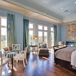 Bedroom - mediterranean dark wood floor bedroom idea in Dallas with blue walls