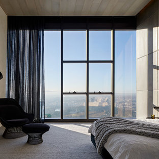 This is an example of a contemporary bedroom in Melbourne with grey walls, carpet and grey floor.