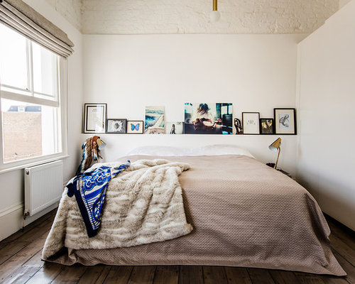 Eclectic Medium Tone Wood Floor Bedroom Photo In London With White Walls