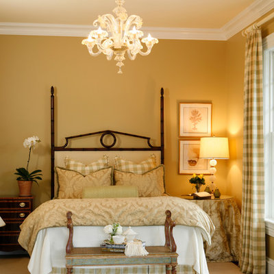 Inspiration for a mid-sized timeless guest carpeted bedroom remodel in New York with beige walls and no fireplace