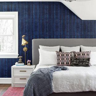 Foto de dormitorio tradicional renovado con paredes azules, suelo de madera oscura y suelo marrón