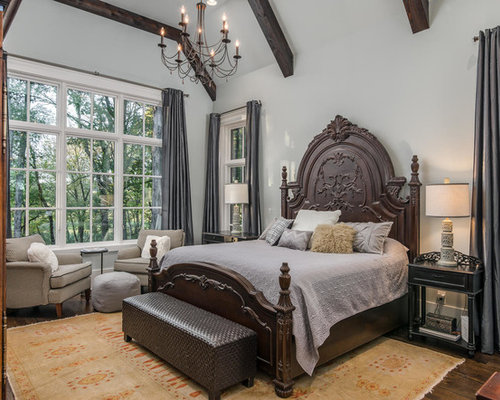 Example Of A Classic Bedroom Design In Other With Gray Walls, Dark Wood  Floors And