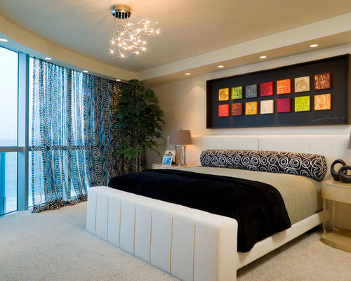 Example Of A Trendy Carpeted Bedroom Design In Miami With Beige Walls