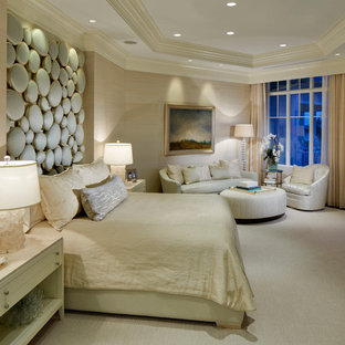 Inspiration for a large transitional master carpeted bedroom remodel in Miami with beige walls