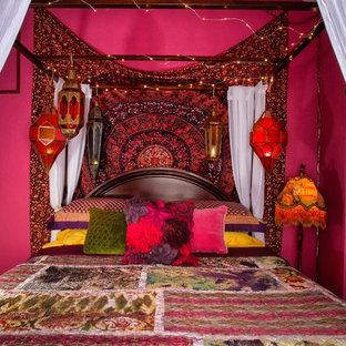 Example of a mid-sized eclectic carpeted bedroom design in Orange County with pink walls and no fireplace