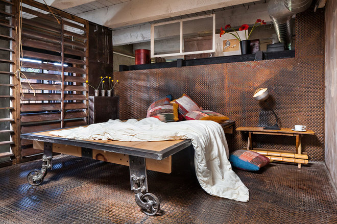 Industrial Bedroom by KuDa Photography