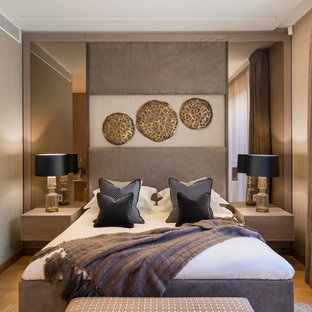 Photo of a contemporary bedroom in London with beige walls, light hardwood flooring and beige floors.
