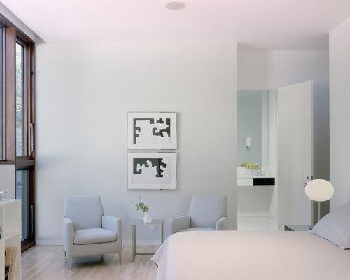 Modern Master Light Wood Floor Bedroom Idea In Nashville With White Walls