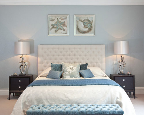 coastal bedroom ideas. Inspiration for a coastal bedroom in Surrey with blue walls  Coastal Bedroom Design Ideas Pictures