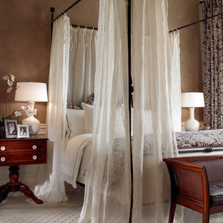 Inspiration for a traditional bedroom in Miami with beige walls and carpet.