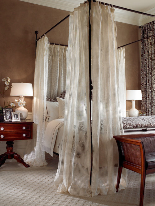 Inspiration for a timeless carpeted bedroom remodel in Miami with beige  walls