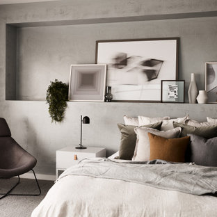 Photo of a contemporary master bedroom in Melbourne with grey walls, carpet, no fireplace and grey floor.