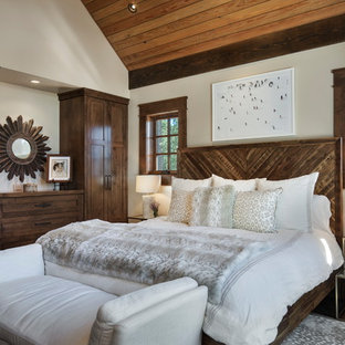 Example of a large mountain style master dark wood floor bedroom design in Sacramento with white walls