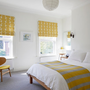 Inspiration for a contemporary bedroom in London with white walls, carpet and grey floors.