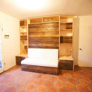 Bedroom - mid-sized contemporary guest terra-cotta floor and orange floor bedroom idea in Los Angeles