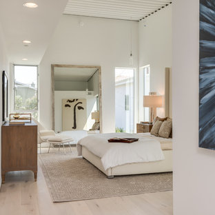 Inspiration for a large contemporary master light wood floor and beige floor bedroom remodel in Los Angeles with white walls