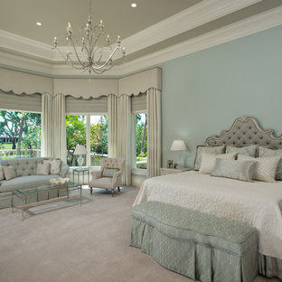 Example of a classic master carpeted and gray floor bedroom design in Other with blue walls