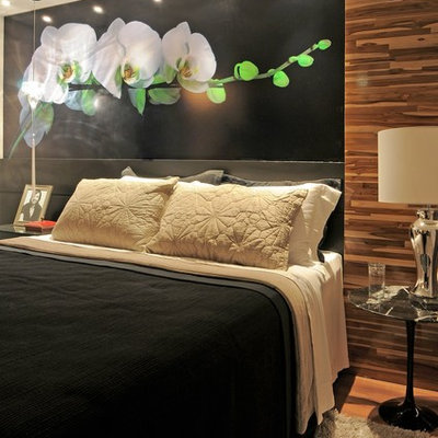 Inspiration for a contemporary medium tone wood floor bedroom remodel in Other with black walls