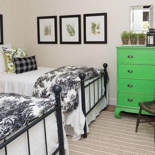 Example of a coastal dark wood floor bedroom design in Ottawa with beige walls