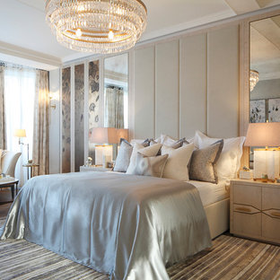 Inspiration for a classic master bedroom in London with beige walls, dark hardwood flooring and no fireplace.