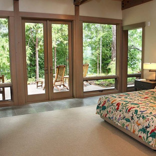 Mid-sized elegant master ceramic tile and gray floor bedroom photo in Seattle with beige walls