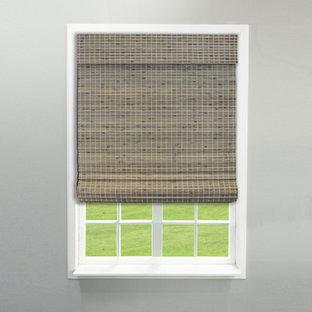 Modelo de dormitorio clásico con paredes grises, suelo de pizarra y suelo gris