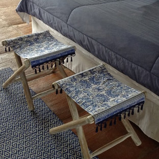 Inspiration for a mid-sized mediterranean master bedroom in Other with terra-cotta floors, no fireplace and beige floor.