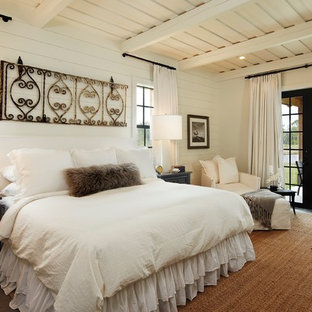 Photo of a country bedroom in Atlanta with white walls and no fireplace.