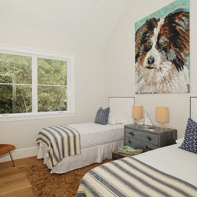 Elegant guest medium tone wood floor bedroom photo in Los Angeles with white walls and no fireplace