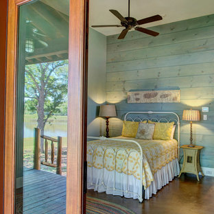 Inspiration for a rustic bedroom in Houston with concrete flooring.