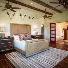 Rustic Bedroom by Thompson Custom Homes