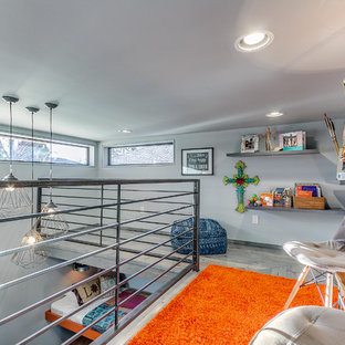 Example of a minimalist loft-style light wood floor bedroom design in Oklahoma City with gray walls