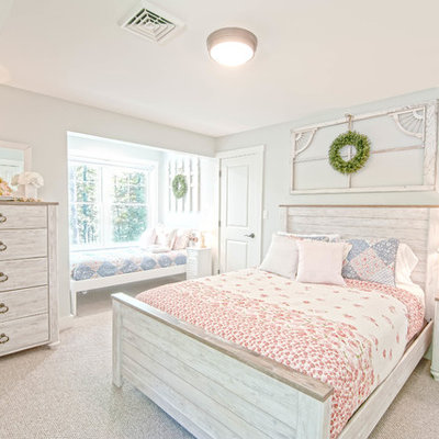 Example of a mid-sized cottage chic guest carpeted and gray floor bedroom design in Portland Maine with blue walls