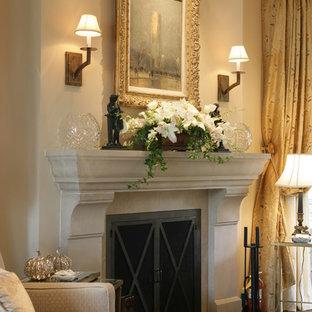 На фото: спальня в классическом стиле с стандартным камином и бежевыми стенами с