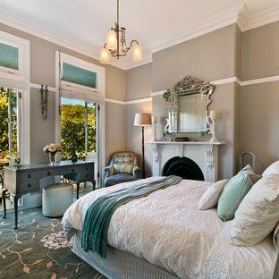 На фото: спальня среднего размера в классическом стиле с коричневыми стенами, стандартным камином, бирюзовым полом, ковровым покрытием и фасадом камина из камня с