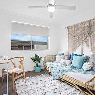 Design ideas for a beach style bedroom in Other with white walls, carpet and brown floor.
