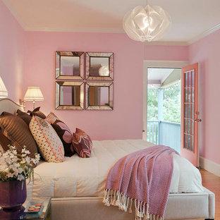 Bedroom - mid-sized eclectic master light wood floor bedroom idea in Orlando with pink walls