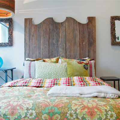 Eclectic bedroom photo in Austin with white walls