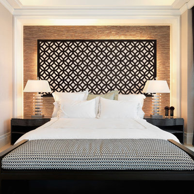 Example of a transitional bedroom design in Austin with beige walls