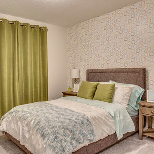 Mid-sized midcentury guest bedroom in Calgary with multi-coloured walls, carpet, no fireplace and grey floor.