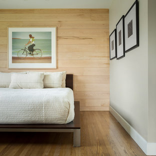 This is an example of a contemporary bedroom in Portland Maine with grey walls, marble floors and brown floor.
