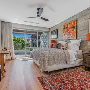Asian master bedroom in Perth with grey walls, medium hardwood floors and beige floor.