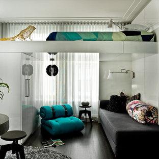 Trendy dark wood floor bedroom photo in Chicago with green walls