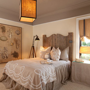 Bedroom - mid-sized traditional guest carpeted bedroom idea in Miami with beige walls and no fireplace