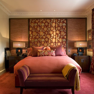 Mid-sized transitional carpeted and red floor bedroom photo in London with beige walls