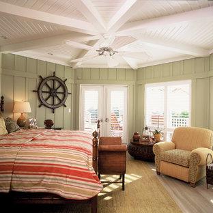 Coastal light wood floor bedroom photo in Santa Barbara with green walls