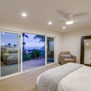 Inspiration for a mid-sized contemporary guest carpeted and beige floor bedroom remodel in San Diego with beige walls