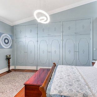 Design ideas for a transitional bedroom in Perth with blue walls, medium hardwood floors and no fireplace.