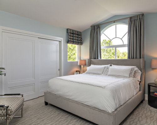 inspiration for a contemporary bedroom remodel in miami with blue walls and carpet