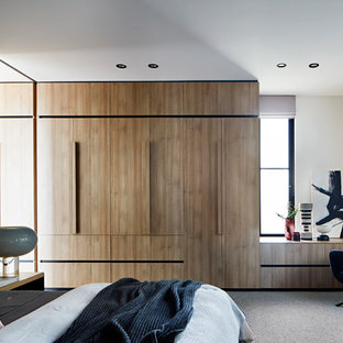 This is an example of a contemporary bedroom in Melbourne.